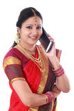 Traditional woman talking on mobile phone stock image