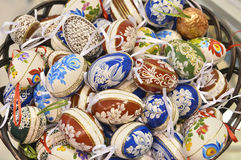 Traditional wood basket with painted Easter egg from Bucovina, Romania. Decorated eggs is an old Easter tradition that was developed on Romanian soil with great Royalty Free Stock Image