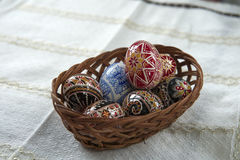 Traditional wood basket with painted Easter egg from Bucovina, Romania. Decorated eggs is an old Easter tradition that was developed on Romanian soil with great Royalty Free Stock Photography