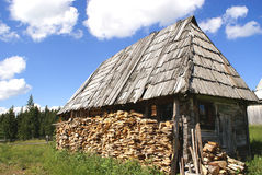 Traditional wood house. In mountains and blue sky background royalty free stock images