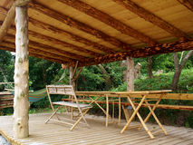Traditional wood pergola in a tropical holiday resort Stock Photos