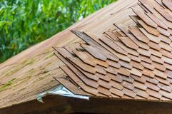 Traditional wood shingle roof being constructed in Bali royalty free stock photo
