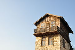 Traditional wood and stone house Stock Image