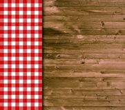 Traditional wooden background with red white tablecloth Stock Photo