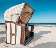 Traditional wooden beach chair on island Ruegen on Baltic sea co. Traditional wooden beach chair on island Ruegen, Mecklenburg-Vorpommern, Baltic Sea, Germany royalty free stock photos