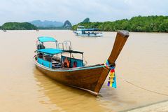 Traditional wooden boat against tropical background Stock Photo