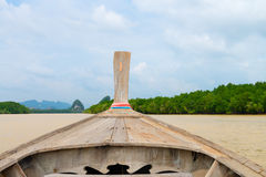 Traditional wooden boat against tropical background Royalty Free Stock Image
