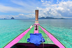 Traditional wooden boat anchored at the crystal clear part of Andaman Sea Stock Photos
