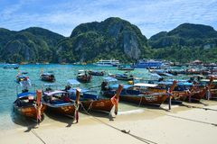 Traditional wooden boat on blue sea stock photography