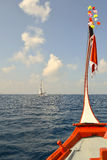 Traditional wooden boat head out into deep blue caribbean sea; y. Acht view royalty free stock photo