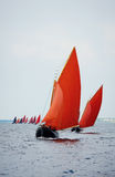 Traditional wooden boat with read sail. Royalty Free Stock Photos