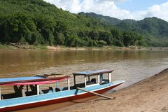 Characteristic wooden boat for transport at the Mekong river,Laos Stock Images