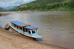 Public transport by very old wooden vessel at Mekong river, Laos  Stock Photos