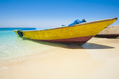 Traditional wooden boat on a tropical beach Stock Image