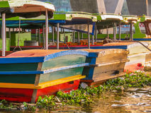 Traditional wooden boats at the Chao Phraya River, Bangkok, Thailand Royalty Free Stock Images