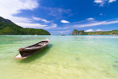 Wooden boat on a tropical beach. Royalty Free Stock Photo