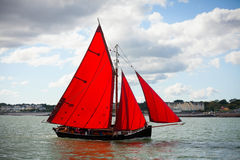 Traditional wooden boats with red sail. Royalty Free Stock Images