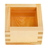 Traditional wooden box masu with sake Stock Images