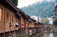 Traditional wooden buildings and ancient stone bridge in Fenghuang Ancient Town, Hunan Province, China. FENGHUNG, CHINA - NOV 12, 2014 - Traditional wooden stock photography