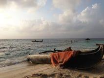 Traditional wooden canoe on he beach Stock Photos