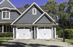 Traditional wooden car garage with driveway. Traditional four car wooden garage with driveway stock images