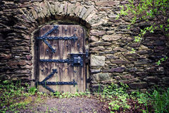 Traditional wooden castle door Royalty Free Stock Photography
