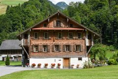 Traditional wooden chalet at Engelberg on the Swiss alps. Engelberg, Switzerland - 12 July 2017: traditional wooden chalet at Engelberg on the Swiss alps Stock Photos