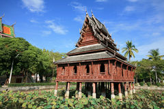Traditional wooden chedi on the lotus pond Royalty Free Stock Photo