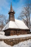 Traditional wooden church covered in snow Royalty Free Stock Photo