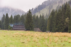 Traditional wooden cottages in Koscielisko valley Stock Photography
