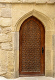 Traditional wooden door with arch in Old city, Icheri Sheher. Baku. Traditional wooden door with curved arch in Old city, Icheri Sheher is the historical core of Royalty Free Stock Photo