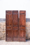 Traditional wooden door in Chinese shop, old town in Lijiang, Yu Stock Photo