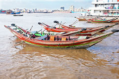 Traditional wooden fisher boats in the harbor from Yangon in Mya Stock Image