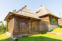 Traditional wooden gazebo on hillside in Kusturica Drvengrad in Serbia stock photography