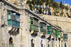 Traditional wooden green balconies, Malta Stock Photo