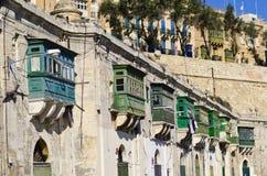 Traditional wooden green balconies, Malta Stock Photo