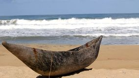 Traditional wooden hand made African / Malagasy fishing boat - piroga on the sandy beach of Indian ocean in Madagascar. Africa stock video