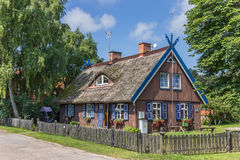 Traditional wooden house on Curonian Spit Royalty Free Stock Photo