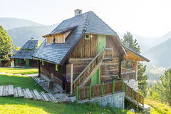 Traditional wooden house on a hillside in Kusturica Drvengrad in Serbia royalty free stock images