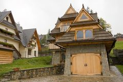 Traditional wooden house in mountains Royalty Free Stock Images
