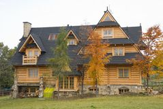 Traditional wooden house in mountains Stock Images