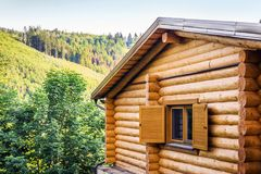 Traditional wooden house in mountains Royalty Free Stock Photos