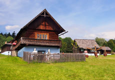 A traditional wooden house in Stara Lubovna. A summer view of an authentic folk house in the open-air museum of Stara Lubovna, located in the Spis region royalty free stock photos