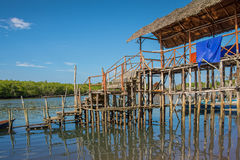 Traditional wooden house on stilts Royalty Free Stock Images