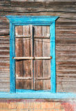 Traditional wooden house window with locked Royalty Free Stock Image