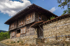Traditional wooden house in Zheravna Jeravna, Bulgaria, Europe. Traditional stone and wood house with beautiful sky in Zheravna Jeravna, Bulgaria, Europe Stock Photography