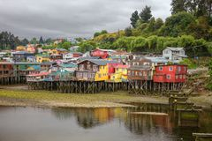 Traditional wooden houses built on stilts palafitos along the. Waters edge in Castro, Chiloe in Chile Stock Photos
