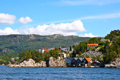 Houses and huts on the shore of  Bergen fjord. Stock Images
