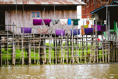 Traditional wooden houses on Inle lake with drying colorful clothes. Myanmar Burma Stock Photography