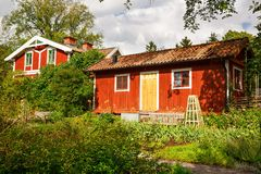 Wooden houses. Traditional wooden houses at Skansen, the first open-air museum and zoo, located on the island Djurgarden in Stockholm, Sweden Stock Photos